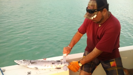 Cleaning the barracuda before heading to shore